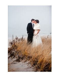 Gorgeous winter wedding in Wading River, New York. Bride in a timeless fur cape and dress by Maggie Sottero.