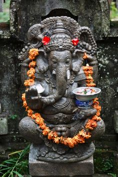 "A Ganesh statue in the courtyard of a Balinese house. Ganesh is worshipped as the ""remover of obstacles"" and it is quite common to see statues of the Elephant God in Balinese households."
