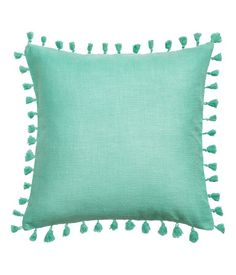 Turquoise. Cushion cover in thick cotton-weave fabric with tassel trim. Concealed zip.
