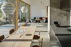 Dive Architects designed this stunner of a house on a lake. There is a Scandinavian feel with this house. All of the Alvar Aalto lighting caught my eye Timber Planks, Floor Slab, Alvar Aalto, Outdoor Seating Areas, Brick Fireplace, Architect Design, Concrete Floors, Elle Decor, Dining Area