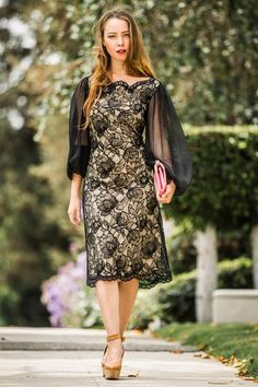 Wow any room when you enter wearing this dress. The dress is unique with a gold foundation covered with black lace and long chiffon sleeves. Make an impression