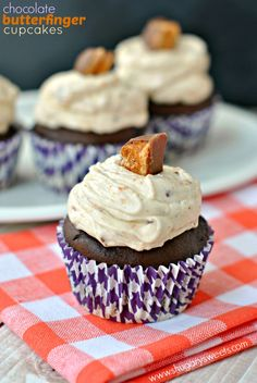 Dark Chocolate Cupcakes topped with a creamy Peanut Butter frosting with chopped Butterfinger candy. YUM