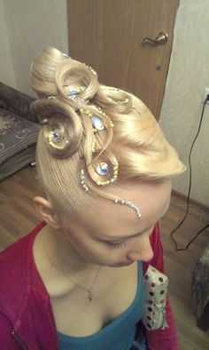 Hair bun with swirls and stones. Good hairstyle for standard. Visit http://ballroomguide.com/comp/hair_make_up.html for more hair and makeup info