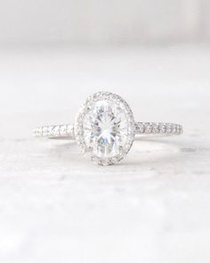 Oval Forever One Moissanite and Conflict Free Diamond Halo Engagement Wedding Ring