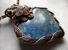 Rhapsody in Blue Lapis Lazuli heart pendant Copper wire wrapped Lapis Lazuli heart pendant. Wire frame has been oxidized for antique look, polished to high shine and sealed with a clear glaze. Comes with a free gift: 20 fancy chain necklace! Dimensions: 6.2X4.8cm=2.4x1.9 Video: