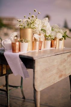 Copper tones  Move over silver and gold, there's a new metallic in town. Copper details look cool, fresh and beautiful next to white blooms and this year's trendy green foliage.