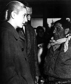 Eva Peron and President Juan Peron speak to a worker, late 1940s