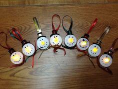 Tea light snowmen with rolled felt hats.
