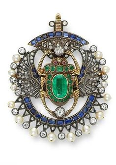 An Egyptian Revival multi gem-set and diamond scarab brooch/pendant, first quarter of the 20th century, length 6.8cm. #EgyptianRevival #brooch #pendant
