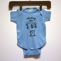 SHOOTING STAR light blue infant onesie. More found here: http://mikekrenner.com/shop/