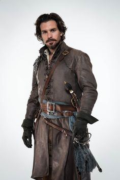 The Musketeers - BBC America. Series Aramis played by Santiago Cabrera. The Musketeers Season 2, Aramis The Musketeers, The Three Musketeers, Musketeer Costume, Aramis And Anne, Fantasy Costumes, Male Costumes, Fantasy Outfits, Medieval Fantasy