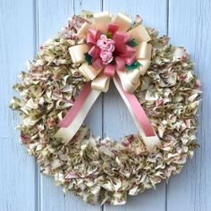 One twin bed-sheet makes a perfect scrap fabric wreath!  Visit the tutorial to learn how.