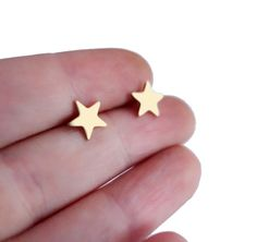 I'm obsessed with these Brass Star Studs by Rachel Pfeffer.