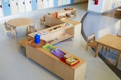 Toddler room. Looks like later in the school year, the shelves are full of materials.  :)