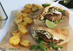 Pita Burgers with Pistachio Crumble, yogurt sauce and parmesan crusted baby potatoes