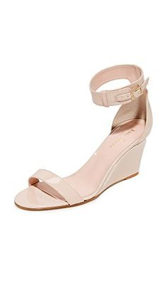 795e8d4cc814 Kate Spade New York sandals composed of sleek patent leather. Buckle  closure at ankle cuff.