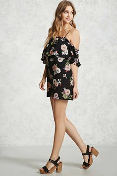 A floral woven mini dress featuring an open-shoulder design with adjustable straps, ruffled trim, flounce layer with short sleeves, and a swing silhouette.