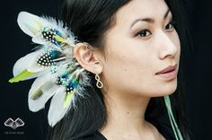 ***The Flying Heads Turquoise Feather Earcuff*** Stunning feather earcuff with turquoise stone for an outstanding and exotic look. You can find tiny parrot feathers ranging from turquoise to aquamarine and greenish yellow colors, dotted guinea fowl feathers and white turtledove and goose feathers. Small turquoise stones sitting on thin wire are giving more dimension to the piece.