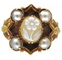 """*Hardstone Flower & Natural Pearl Late Georgian Ring Georgian (1714-1830)Item No. 232F An unusual 18ct gold Mourning ring which has been engraved with the date 1837 on the inside of the shank. The hardstone is a carved flower which is a pansy, a play on words """" Pensee a moi """" Literally translated """"Think of me"""". The Georgian and Victorian jewellery was full of hidden meanings either with the use of stones or imagery."""