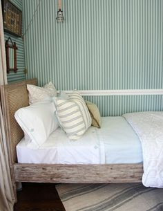 source: Tammy Connor Interior Design via Habitually Chic - Cottage boys' room with twin salvaged wood cane bed paired with white and blue bed linens, blue striped wallpaper with chair rail, vintage French grain sack rug and natural linen curtains. Wooden Bed Frames, Wood Beds, Dream Bedroom, Home Bedroom, Bedroom Ideas, Cottage Bedrooms, Childs Bedroom, Coastal Bedrooms, Guest Bedrooms