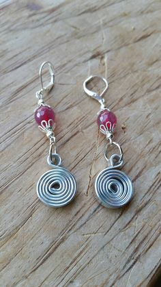 Check out this item in my Etsy shop https://www.etsy.com/listing/293379637/sale-silver-circle-spiral-earrings-pink