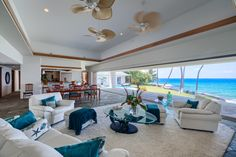 """The exquisite great room lets the sunshine and """"sea"""" forever views inside."""