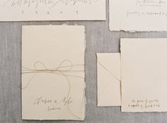 meagan-tidwell-callicraphy-ivory-handmade-paper-invitation-suite-bow-twine-blind-embossed.jpg