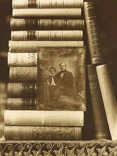 Books with a portrait of the child Émile Zola and his father, ca 1901 -by Émile Zola