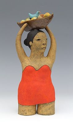clay ceramic figure with fruit and bird by sara swink