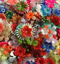 I had a kit like this one.  Used most of it up creating a book week display of Alice in Wonderland in the garden down the rabbit hole!  It was beautiful.  I remember it brighter than this.  30pcs PLASTIC FLOWERS STACKING 1960s by cOveTableCuriOsitiEs, $8.95