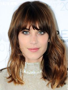 This is the trending cut for Fall. Full bangs provide the illusion of volume - I'm stumped by this one. I've always thought heavy bangs = less hair for someone with already fine hair, that is you don't want to spare too much from the length for bangs or layers IF you already have fine hair