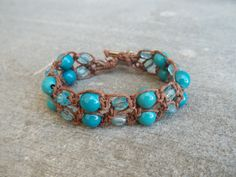Beautiful brown hemp and turquoise beaded bracelet.