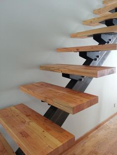 Single steel stringer stair with custom tread bracket and glulam tread.