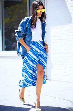 Style Notes: Steal his denim jacket and wear it over a boyfriend T-shirt and afeminine midi skirt for a powerful play on ladylike and rock.