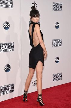 Kendall Jenner picked a backless black mini (and new bangs!) for the AMAs this year. Click for more red carpet!