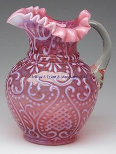 *ARABIAN NIGHTS WATER PITCHER ~ cranberry opalescent, crimped triangular rim, colorless applied handle w/ pressed fan design at upper terminal. Possibly Beaumont Glass Co., late 19th Century.