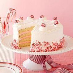White Christmas Peppermint Layer Cake: Fanciful pink peppermint frosting and snowy cake layers will brighten any holiday party. Recipe: http://www.midwestliving.com/recipe/white-christmas-peppermint-layer-cake/