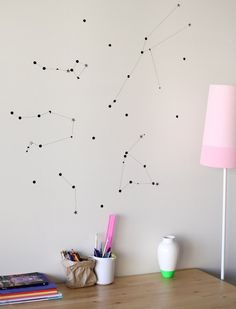Star gazing is a perfectly traditional childhood activity, the nighttime version of watching the clouds roll by. Whether your kids are interested in the actual constellations or are simply fascinated by outer space, this minimalist, clean wall design is simple to construct and beautiful for a wall or ceiling.
