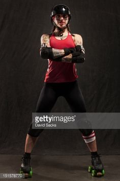 Stock Photo : Portrait of young woman with roller derby skates