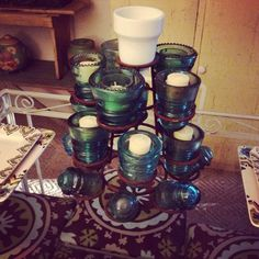 The centerpiece I made with a rusty apple holder, old glass insulators, and ivory votives.