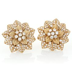 Van Cleef & Arpels Diamond and Gold Flower Ear Clips.  Available exclusively at Macklowe Gallery.
