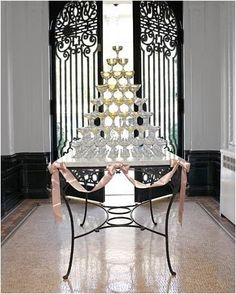 Old Hollywood glamour is all about the champagne and the extravagance. this champagne tower is so inviting