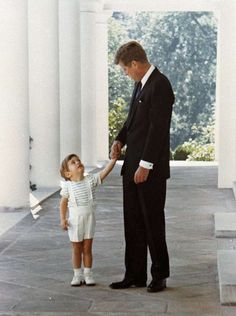 In this 1963 file photo, U. President John F. Kennedy holds hands with his son, John F., in 1963 outside the White House in Washington. A documentary film on John Kennedy Jr.'s life opens Friday, July in select theaters. Jacqueline Kennedy Onassis, John F Kennedy, Estilo Jackie Kennedy, Les Kennedy, Jaqueline Kennedy, Caroline Kennedy, Greatest Presidents, American Presidents, Us Presidents