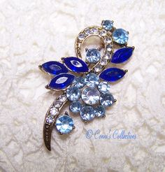 Vintage Rhinestone Brooch Blue Gold Tone Juliana Style wear any direction! by ConnisCollections on Etsy