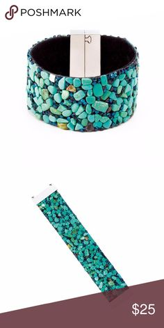 Magnetic Wide Turquoise Stone Bracelet Looking stylish has never been so easy! This wide bracelet has a magnetic closure that's a 'snap' to fasten and unfasten. The assortment of turquoise-color stones set on the fabric band make a stylish statement. Jewelry Bracelets