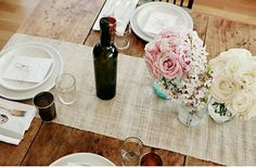 burlap for an inexpensive table runner that is simple and rustic, yet elegant.