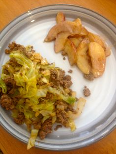 grass-fed beef with cabbage, apples sauteed in coconut oil with cinnamon and coconut milk.  Recipe from Everyday Paleo