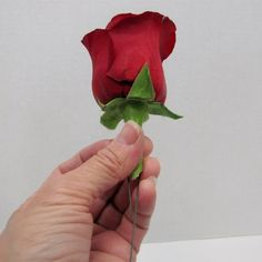 Learn how to make boutonnieres and matching corsages.  Free wedding flower tutorials.  Buy wholesale flowers and professional florist supplies
