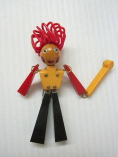 "vintage Bakelite articulated figure Drum Major brooch pin in three colors of Bakelite with red Celluloid head piece - measures 4"" tall - sold for $780 on eBay on 2/1/14"