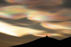 Nacreous clouds ten miles above the earth. Taken at McMurdo Antarctic research station by Chad Carpenter.